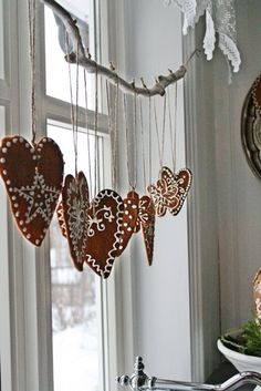 Hanging gingerbread cookies for a cinnamon scented room.