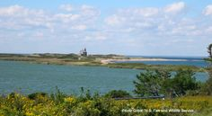 Panorama of Block Island National Wildlife Refuge, including North Light House, Sachem Pond and the Atlantic Ocean separated by a narrow str...
