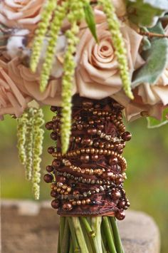 Great beaded handle. awesome attention to detail...with the weathered terra cotta coloured roses, (saharas, maybe?) looks divine.