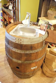 And where have I seen such pretty seltzer bottles before? Wine Barrel Sink, Whiskey Barrel Table, Wine Barrels, Napa Style, Outdoor Sinks, Backyard Bar, Mud Kitchen, Wagon Wheel, Bars For Home