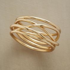 FINE LINES RING -- Slender strands of 18kt gold plate are intricately intertwined, forever connected, as they circle your finger just so. Whole sizes 6 to 8..polishingCloth {display:none