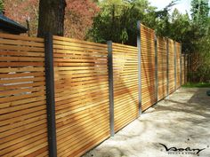 Slatted wooden fencing with metal posts