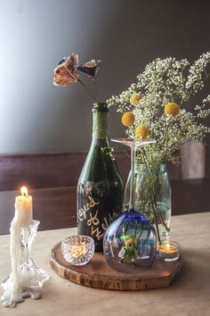 DIY wedding table centerpiece. Legend of Zelda, baby's breath and billy balls, votives and candlestick, wine glass, wood centerpiece