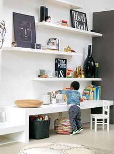 Love the open shelving and the kiddos table ledge.