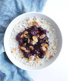 Barley Breakfast Bowl With Mixed Berry Compote | This hearty breakfast is packed with whole-grains, fruit, chia seeds and nuts, making it a nutritional powerhouse. Make the barley and compote the night before, and in the morning, simply reheat and top with milk and almonds.