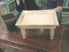 DIY Tray Table: Create a tray out of table legs (cut down to size), a flat board for the tray and a thrift-store frame. Attach all of the pieces, paint and when dry, add a handle on each side.