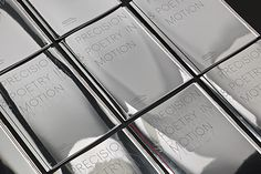 Mirror covers featuring foiled and blind embossed typography. Design by Domenic Lippa.