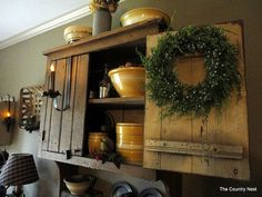 Mustard hanging cabinet with yellow ware and a touch of Christmas.