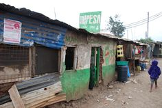 n M-PESA franchise - against the odds, mobile banking has transformed life in urban slums.
