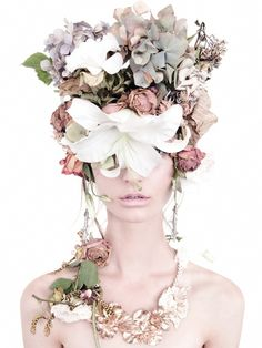 Flowers in her hair... And on her face... and around her neck... And..... flowers