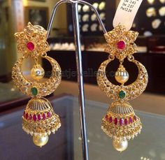 These earrings are really pretty, a little bit different from the norm. They would work really well for an indian/pakistani bride Jewellery Designs: Huge Chandbali Designed Jhumkas Gold Jhumka Earrings, Gold Diamond Earrings, Gold Earrings Designs, Coral Earrings, Diamond Jhumkas, Jhumka Designs, Peacock Earrings, Indian Earrings, Indian Jewellery Design