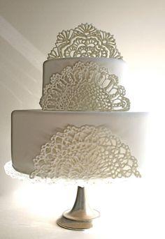 Edible sugar doilies for your wedding cake via Etsy.