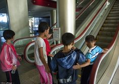 Children in North Korea seeing an escalator for the first time.