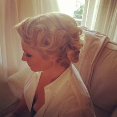 1920s inspired - looser finger curls, nothing too severe, has to frame the face.