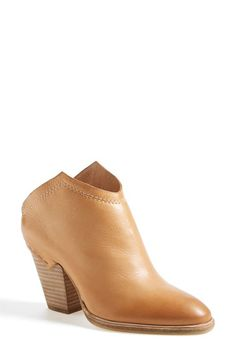 Free shipping and returns on Dolce Vita 'Haku' Ankle Bootie (Women) at Nordstrom.com. A stacked-heel bootie is a little bit Western and refreshingly modern, thanks to a sharply cut shaft that shows off its angles and an exposed-staple overlay at the back. A surprisingly versatile piece that will make everyone do a double-take.