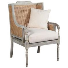 """Mahogany wood accent chair with woven cane paneling and a raw silk cushion.   Product: Chair   Construction Material: Mahogany and raw silk   Color: Gray wash and driftwood   Features: Raw silk seat cushion included   Dimensions: 44"""" H x 30.25"""" W x 29"""" D   Note: Accent pillow not included"""