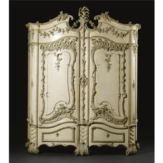 An important and rare German ivory painted and carved silvered wood schrank by Johann August Nahl (1710-1781), Potsdam circa 1760