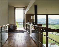 Bookshelf built into woodwork below and railing: Sonoma Vineyard Estate / Aidlin Darling Design