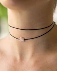 The Isabella Choker Necklace from Meridian Ave fashion jewelry is a top selling choker necklace and it is easy to see why. This Black Nylon double wrap choker with pave disk charm (Available in Gold,