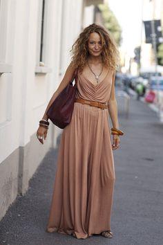 tan colored maxi dress, chunky bangles. really stylish.