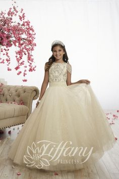 Style 13527 from Tiffany Princess is a cold shoulder girl's pageant ball gown with short sheer beaded sleeves, a beaded bodice, a pleated waistband, a cutout back with lace-up, and a full sparkle tulle skirt. Kids Pageant Dresses, Pageant Gowns, Girls Party Dress, Girls Dresses, Prom Dresses, Pageant Hair, Bridesmaid Gowns, Birthday Dresses, Formal Dresses