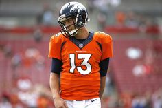 Trevor Siemian Photos Photos - Quarterback Trevor Siemian #13 of the Denver Broncos warms up before the start of an NFL game against the Tampa Bay Buccaneers on October 2, 2016 at Raymond James Stadium in Tampa, Florida. - Denver Broncos v Tampa Bay Buccaneers