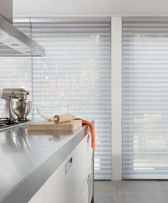 The chic design of Silhouette® window shadings add function with style to enlighten this kitchen. ♦ Hunter Douglas window treatments