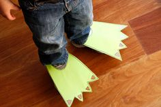 (For a complete list of our theme month projects, click here!) Isaiah had so much fun walking in our dinosaur tracks, we figured why not make our own dinosaur feet? You could easily sew a pair, or simply cut some … Continued