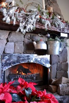 I like the metal addition to the fireplace opening...looks homemade.