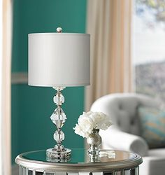 A plush table lamp in a luxe faceted crystal base design.Different shaped crystals in the base adds visual interest and depth to the design. A crisp white table lamp completes the gorgeous look. Buffet Table Lamps, White Table Lamp, Table Lamp Sets, Kids Lamps, Selling Design, Bedroom Night Stands, Home Gifts, Desk Lamp, Modern Design