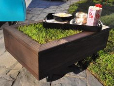A Coffee Table That Grows. On a warm summer's evening, an outdoor coffee table filled with sod is the perfect place to put your feet up and feel the grass between your toes.