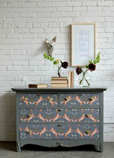 If a coat of paint simply isn't enough to makeover that garage sale find, try adding a quirky fabric to the drawers for unique twist.