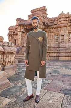 Just when we thought weve spotted all possible experimental outfit options for grooms we got our hands on this spectacular olive green indo-western outfit meticulously crafted with antique gold zardozi work. Wedding Kurta For Men, Wedding Dresses Men Indian, Wedding Dress Men, Wedding Men, Desi Wedding, Wedding Outfits, Wedding Decor, Indian Men Fashion, Mens Fashion Suits
