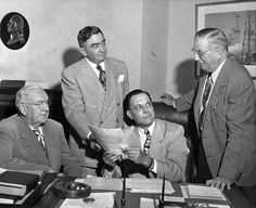 July 1, 1947. Law enforcement officers are shown at an 'information pool' conference today on the gang rubout of Bugsy Siegel. Left to right are District Attorney William E. Simpson, Sheriff Eugene W. Biscailuz, Walter H. Lentz, chief special agent of the State Department of Justice, and Undersheriff A. C. Jewell.  http://photos.lapl.org/carlweb/jsp/FullRecord?databaseID=968=107=4958789