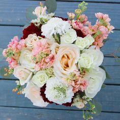 For the bridesmaids matching garden style bouquets of roses stock and scabiosa!  #thefloralcottageflorist #bridesmaidbouquet #louisianaweddings #batonrougewedding #nolaweddings #winterwedding #januarywedding #peachwedding #scabiosa #roses