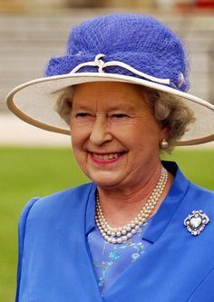 Queen Elizabeth II wearing a most unusual hat!