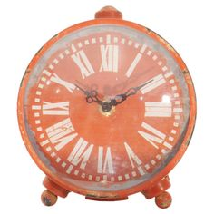 Antiqued iron table clock with a Roman numeral dial.  Product: Table clockConstruction Material: Iron and glass