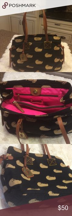 Dooney & Bourke bag Dooney and Bourke. Cloth with leather handles and trim.  Used once. Bags Totes