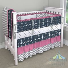 Crib bedding in White and Gray Polka Dot, Navy Anchors, White and Gray Zig Zag, Bright Pink Pindot, Solid White, Solid Cloud Gray. Created using the Nursery Designer® by Carousel Designs where you mix and match from hundreds of fabrics to create your own unique baby bedding. #carouseldesigns