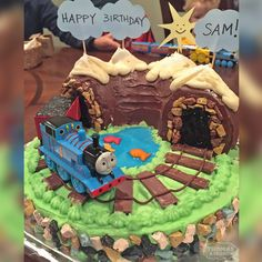 This homemade Thomas train birthday cake uses rock candy, a bundt cake, and clever candy details for the tracks. Brilliant! #thomasthetrain #thomasthetank #birthdaycakes #birthdayideas #thomasandfriends