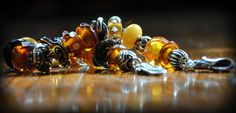 A beauty of an amber bracelet with special retired Trollbeads From a Trollbeads Gallery Member! Check out the unique amber Trollbeads! http://www.trollbeadsgallery.com/categories/All-Unique-Beads/Amber-Unique-Beads/
