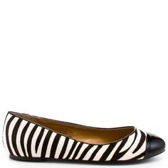 You'll be queen of the jungle in these animal print inspired flats from Kelsi Dagger.  Jordi has a zebra faux pony hair upper with a black patent detail at the vamp.  Add some zest to your wardrobe with these fierce ballet flats.