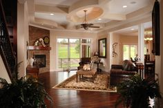Design 42057 the Palmer.  The great room, kitchen and eating areas are all open promoting traffic flow and conversation.  Yet the are defined by varying ceiling heights and finishes, partial walls and a pillar.