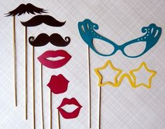 Cute photo booth idea for a wedding or shower! Have guests pose with the props for extra fun pictures of the event.