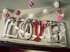 Garland for any holiday out of coffee filter flowers and cupcake wrappers. #Garland