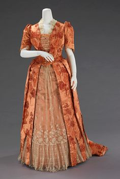 "Dinner Dress: ca. 1886, American, silk. ""The bustle silhouette, although primarily associated with the second half of the 19th century, originated in earlier fashions as a simple bump at the back of the dress, such as with late 17th-early 18th century mantuas and late 18th- early 19th century Empire dresses. The full-blown bustle silhouette had its first Victorian appearance in the late 1860s, which started as fullness in skirts moving to the back of the dress."""