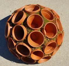 Clay Pot Sphere...yes...DIY! Add your own stunning succulents or create an herb garden...How cool is this? Amazing!