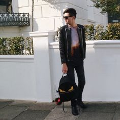 Brighton street style - wearing Balmain biker jacket, jeans and shoes; Christopher Kane galaxy top, Fendi monster eyes backpack and Lucifur bag bug fur charm.