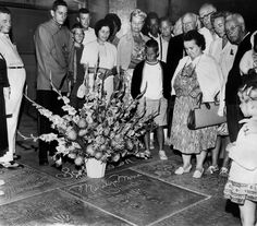 """""""On the day Monroe's death was announced, a crowd gathered near her handprints outside Grauman's Chinese Theatre in Hollywood"""" - Los Angeles Times"""