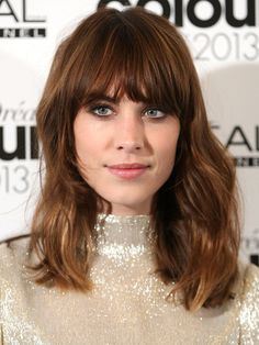 Alexa Chung: Shaggy layers ( If you have a round or oval-shaped face, ask your stylist for brow-skimming fringe that angles down near the temples )